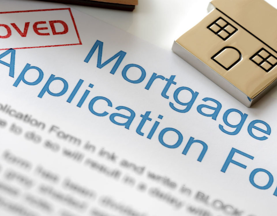 25087781 - approved mortgage loan application with house key and rubber stamp